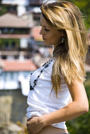 Beautiful young woman posing stock photo, Beautiful young model posing outdoor by Desislava Dimitrova