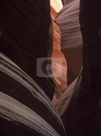 Slot Canyon Shadows and Colors stock photo, Upper Antelop Canyon, near Page, Arizona, is a concert of dark and lihgt, vividly saturated color, and a mysterious atmosphere that whispers,