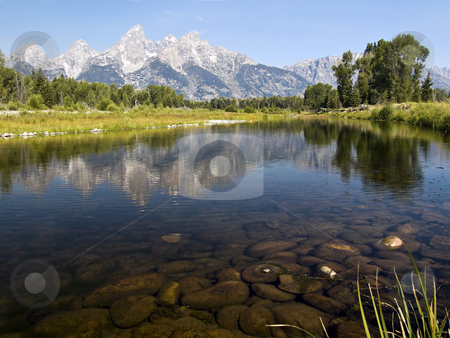 Teton Reflection at Schwabacher's Landing stock photo, The Cathedral Group, Tetons Range, reflected in a still water beaver pond on the Snake River at Schwabacher's Landing, Grand Teton National Park, Wyoming. by Kenneth Keifer