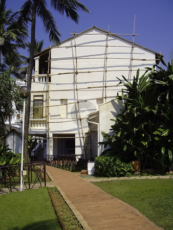 Sri lankan scaffolding 2 stock photo, Typical bamboo scaffolding being used to re paint the hotel walls by Mike Smith