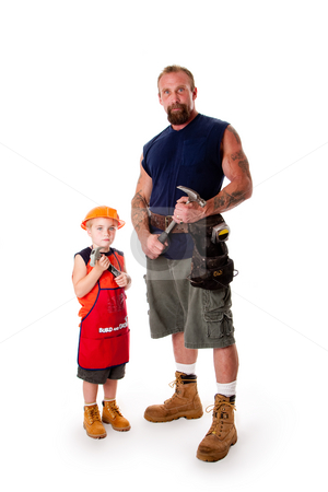 Father and son Carpenter stock photo, Caucasian middle aged father and cute young son ready to do a construction job. Man and boy wearing tool belt and holding hammers, wearing shorts and boots, standing, isolated. by Paul Hakimata