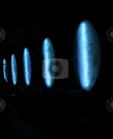Bar Abstract stock photo, Dark abstract photo taken in a bar, showing unusual fiberglass light covers _just_ lighting a row of bottles by Darren Booth