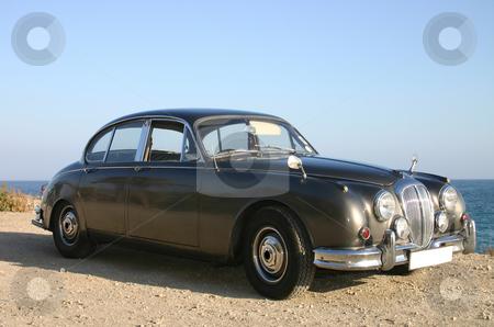60s bronze luxury family car stock photo, 60s bronze luxury family car side 3/4 profile by Darren Booth
