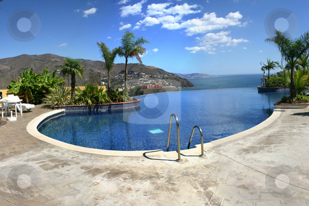 Infinity Pool stock photo, Large image of an infinity pool overlooking the sea and mountains. by Darren Booth