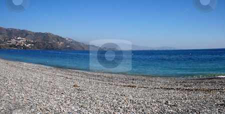 Empty Beach stock photo, Large image of an empty beach with mountains in the background by Darren Booth