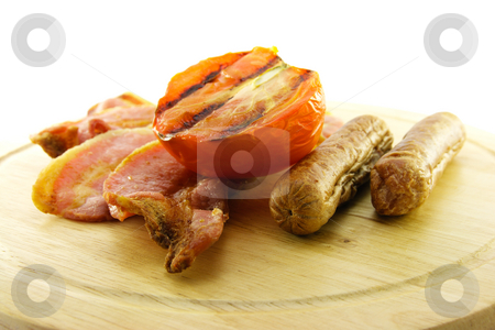 Cooked Breakfast Items on a Wooden Plate stock photo, Delicious cooked breakfast items on a wooden plate on a white background by Keith Wilson
