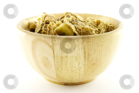 Bran Flakes in a Woodden Bowl stock photo, Crunchy delicious looking bran flakes in a wooden bowl on a white background by Keith Wilson