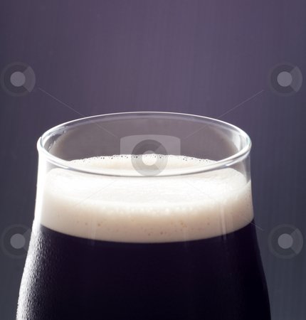 Beer stock photo, Close up of a glass of irish stout by Fabio Alcini