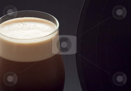 Beer and music stock photo, Close up of a glass of irish stout with a vinyl record by Fabio Alcini