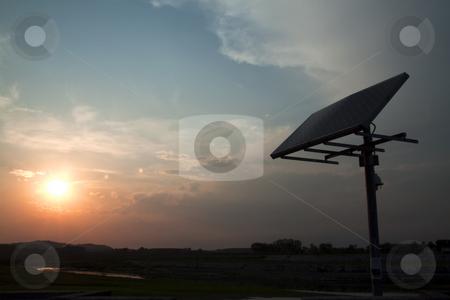 Solar panel stock photo, Closeup of a solar panel, blue sky, sun setting by Fabio Alcini