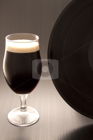 Beer and vinyl record stock photo, Close up of a glass of irish stout with a vinyl record by Fabio Alcini
