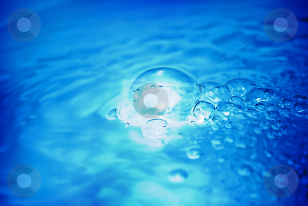 Blue Bubbles stock photo, Beautiful blue bubbles floating on the water by Martin Cuevas