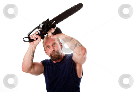 Crazy guy with chainsaw stock photo, Crazy Caucasian man with tattoos and chainsaw above his head with strong expression in eyes, isolated. by Paul Hakimata