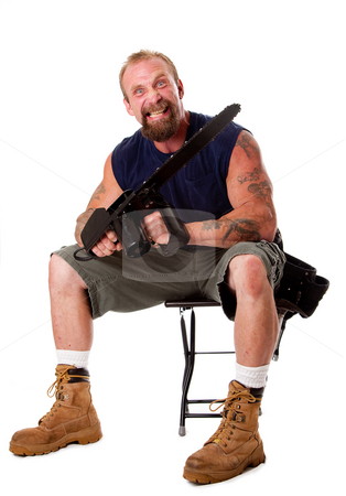 Crazy guy with chainsaw stock photo, Crazy Caucasian man with tattoos and chainsaw sitting on stool with strong facial expression, isolated. by Paul Hakimata