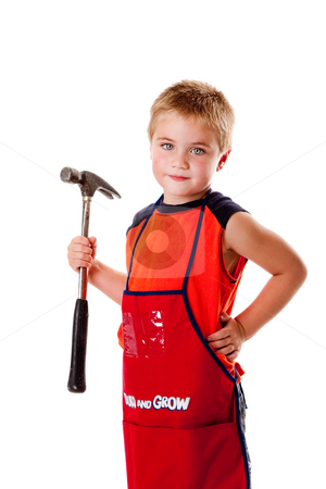Boy with hammer stock photo, Cute young boy holding heavy duty hammer and wearing orange apron with pockets for tools, isolated. by Paul Hakimata