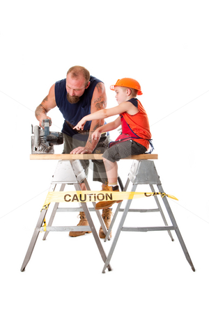 Dad with son and circle saw stock photo, Cute son is helping dad cutting a wooden plank with a heavy duty circle saw as he is pointing out how to do it, isolated. Boy sitting on wooden board and pointing at circle saw that his father is using. by Paul Hakimata