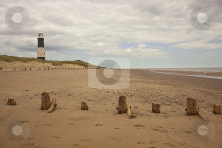 Spurn lighthouse stock photo, A lighthouse and a beach in summer by Mike Smith