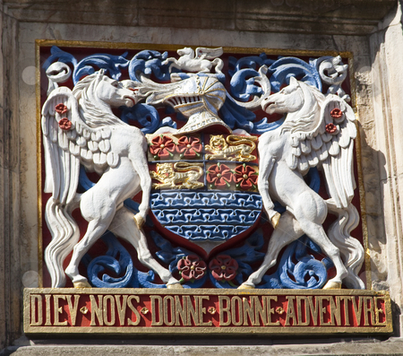 Colourful coat of arms stock photo, Brightly coloured coat of arms in historic city centre by Mike Smith