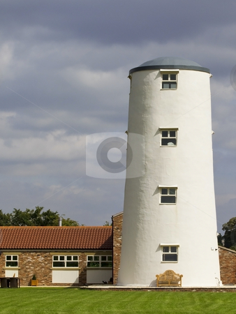 Converted windmill stock photo, An old windmill converted for accomodation by Mike Smith