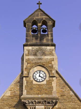 Clock tower in summer stock photo, A decorative clock tower with two bells against a blue summer sky by Mike Smith