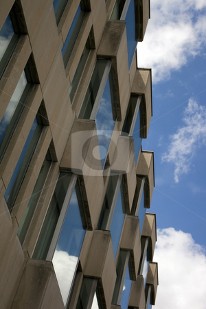 Reflections on contemporary architecture 2 stock photo, Reflections of summer sky in windows of a modern city building by Mike Smith
