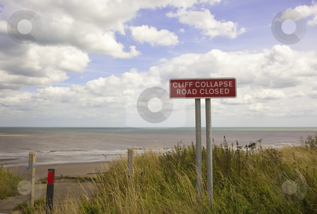 End of the road stock photo, A cliff collapse sign in summer under a blue sky by Mike Smith