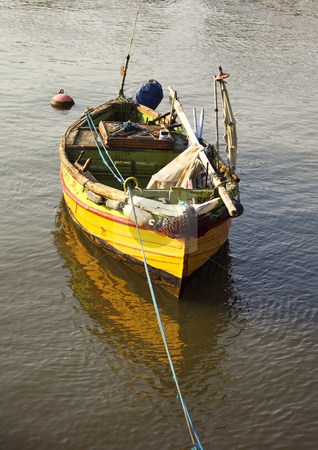 Small fishing boat stock photo, A small fishing boat moored in a harbour by Mike Smith
