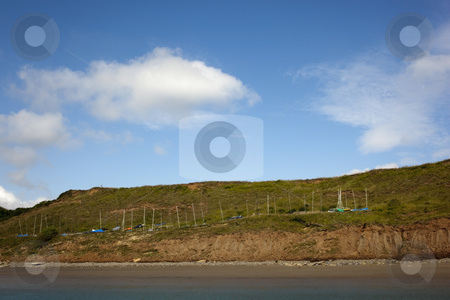 Boats on a hill  stock photo, A line of boats on a hill by the coast in summer by Mike Smith