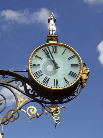 Ornamental clock in city stock photo, An ornamental clock in city centre by Mike Smith