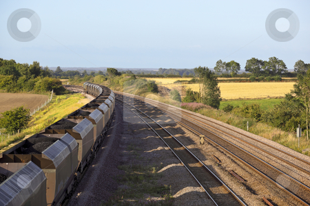 Coal train stock photo, A coal train on railway tracks on a summers day by Mike Smith