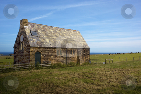 Old church in rural setting stock photo, An old church in a rural coastal setting in summer by Mike Smith