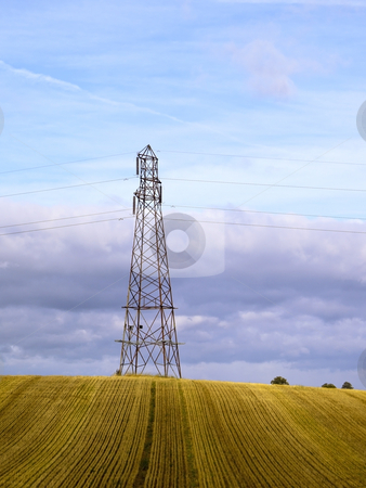 A pylon in a field stock photo, An electricity pylon standing in a field in summer by Mike Smith