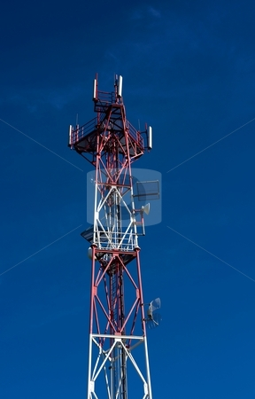 Detail of telecommunicatiopn tower stock photo, Detail of red white telecommunication tower on blue sky by Juraj Kovacik
