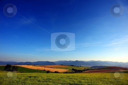 Country evening summary stock photo, Country summer scenery with fields, meadows and big blue sky by Juraj Kovacik