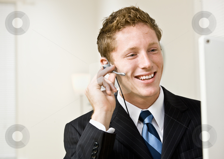 Businessman talking on headset stock photo, Businessman talking on headset by Jonathan Ross