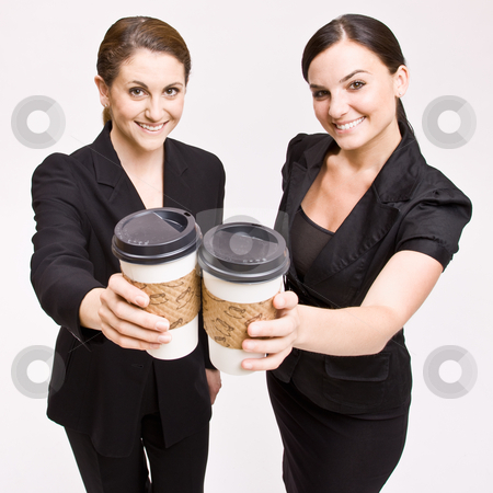 Businesswoman toasting with coffee cups stock photo, Businesswoman toasting with coffee cups by Jonathan Ross