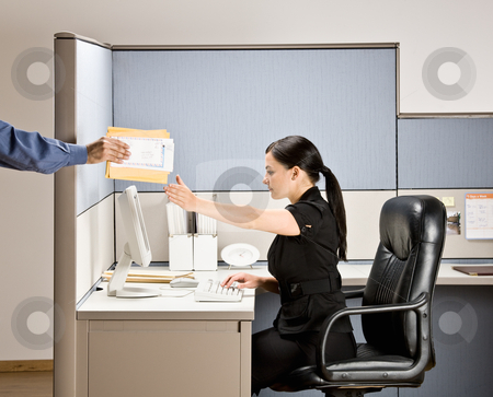 Businesswoman multi-tasking at desk in cubicle stock photo, Businesswoman multi-tasking at desk in cubicle by Jonathan Ross