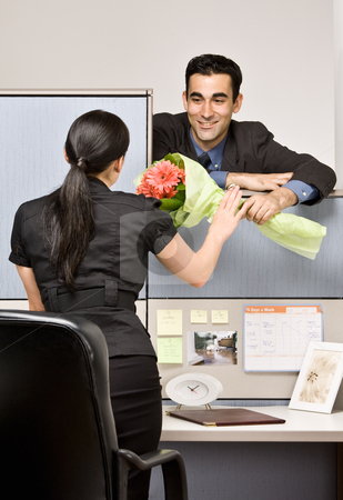 Businessman giving co-worker flowers stock photo, Businessman giving co-worker flowers by Jonathan Ross