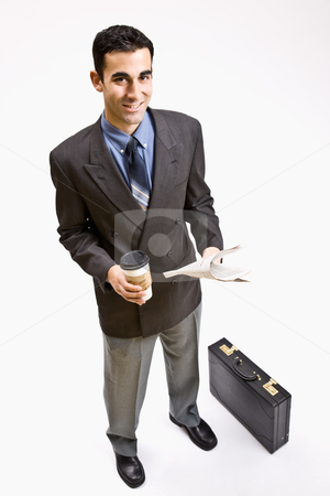 Businessman with coffee and newspaper stock photo, Businessman with coffee and newspaper by Jonathan Ross