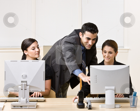 Businessman helping co-worker with work stock photo, Businessman helping co-worker with work by Jonathan Ross