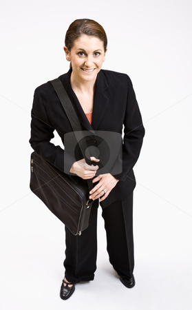 Businesswoman carrying briefcase stock photo, Businesswoman carrying briefcase by Jonathan Ross