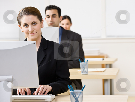 Businesswoman typing on computer stock photo, Businesswoman typing on computer by Jonathan Ross