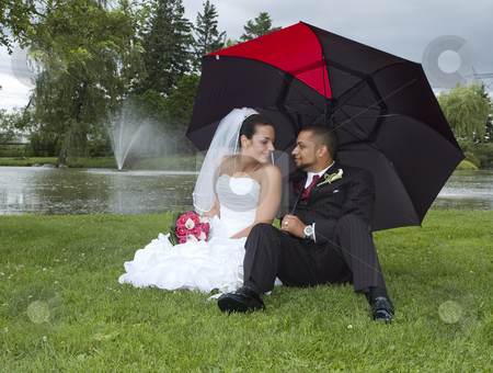 Married couple stock photo, Just married multi ethnic couple looking at each other by Vlad Podkhlebnik