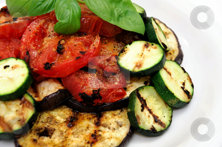 Grilled Eggplant And Veggies stock photo, Eggplant, zuchinni squash and tomatoes topped with fresh basil served on a white plate by Lynn Bendickson