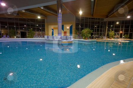 Exclusive swimming pool stock photo, Exclusive swimming pool at night by Istv??n Cs??k