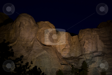 Mount Rushmore at night stock photo, Mount Rushmore at night lit by lights by David Gallaher