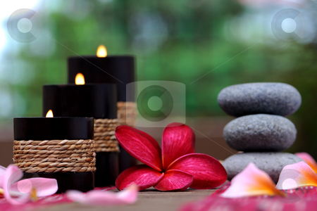 Spa candle  stock photo, Spa candle and plumeria with stone by Jaggat Images