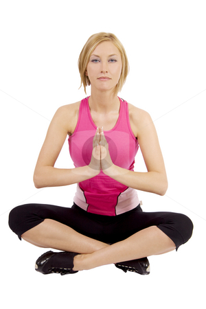 Woman doing yoga stock photo, Blond woman doing yoga and sitting in lotus position by Daniel Kafer