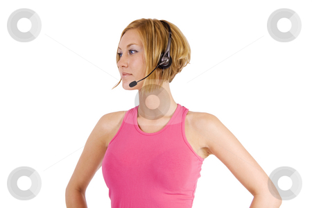 Woman with headset stock photo, Fitness woman with headset looking to the side by Daniel Kafer