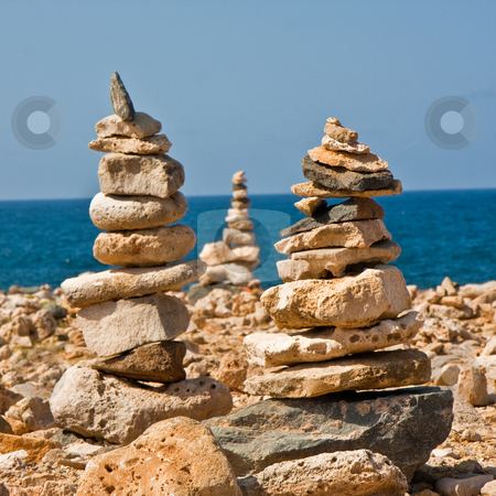 Rock Stacks stock photo, Stacks of rocks for luck, on a rocky beach. by Tyson Koska